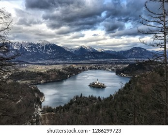 Top view on Bled Lake, Island, Catholic Church and Castle in winter. Julian Alps in the background. Slovenia, Europe.