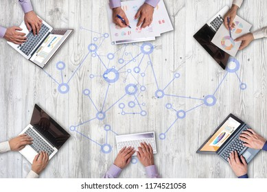 Top view on business people working together in the office and using gadgets