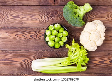 Top view on cabbage, broccoli, cauliflower, Brussels sprouts and celery -ingredients for vegetarian dishes