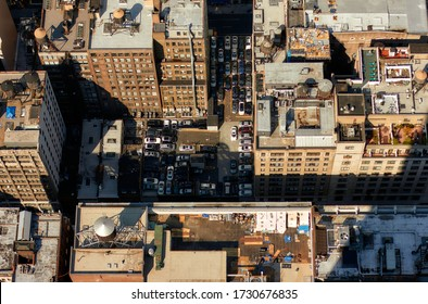 Top view on the cars in the parking lot in New York. View from skyscrapers on the streets of New York City. Problem with parking