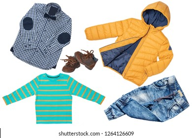 Top view on child boy set of clothes. Collage of apparel clothing. Jeans , shirt, shoes and warm down jacket isolated on a white background. Autumn and winter fashion.