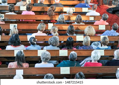 Top view on a Christian community at a church service or concert in a church - selective focus