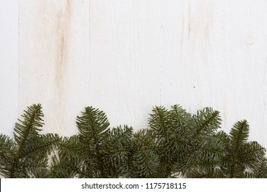 Top view on Christmas or New Year background: fur-tree on old white wooden table. Celebration, holiday season and winter concept