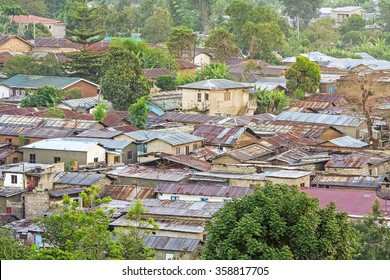Top view on city roofs at hazy dawn. Arusha, Tanzania.