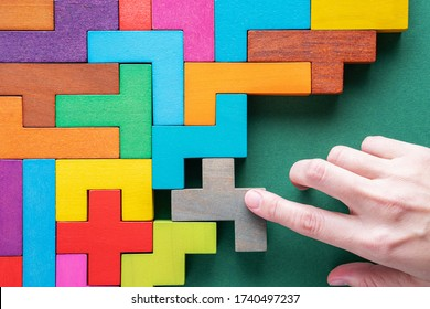 Top view on colorful wooden blocks. Concept of decision making process, logical thinking. Logical tasks