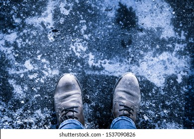 Top view on a completely cold and icy feet in the Winter