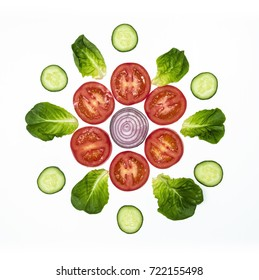 Top view on different kind of vegetables arranged in circle shape isolated on white background.