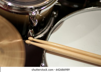 Top view on drums closeup and drum sticks.