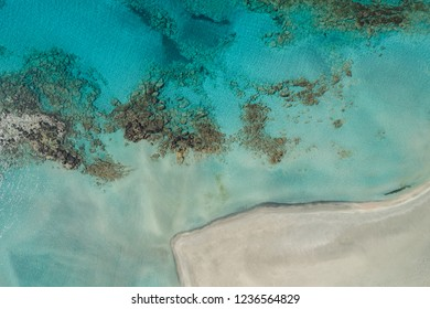 Top view on Elafonisi Beach in Greece by drone. Turquoise sea and lagoon