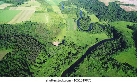 top view on field, trees and river
