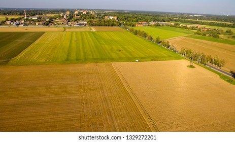Top view on flat geometric areas of an agricultural field