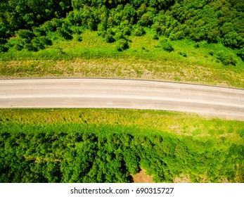 Top view on forest countryside road aerial shot