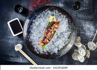 Top view on fresh sliced eel sashimi served in bowl with ice on dark background. japanese food sashimi. Japan restaurant menu. Copy space for design. Top view seafood. Healthy meal