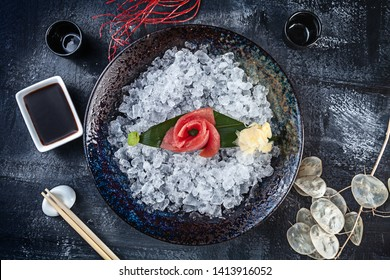 Top view on fresh sliced tuna sashimi served in bowl with ice on dark background. japanese food sashimi. Japan restaurant menu. Copy space for design. Top view seafood. Healthy meal