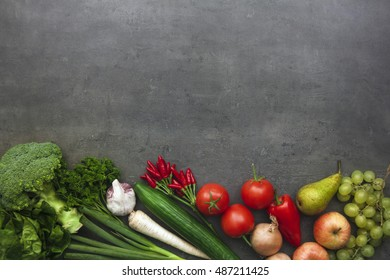 Top view on fresh vegetables and fruits on kitchen table. Flat lay food background.