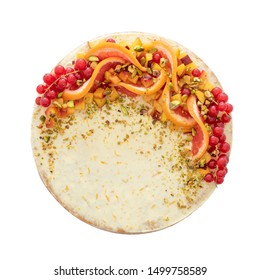 Top view on homemade vanilla birthday cake decorated with orange, peach and gooseberries isolated on white background. Celebration, party cake.
