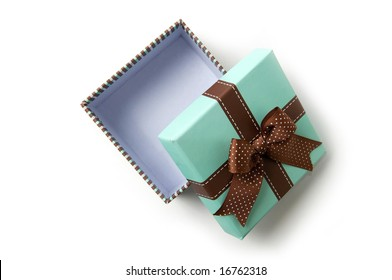 Top view on isolated open striped gift box with brown ribbon