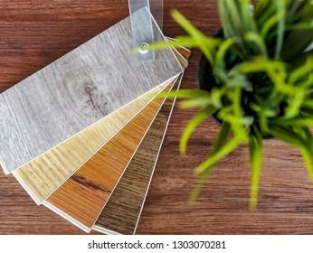 top view on Luxury wood plank laminate vinyl floor tile color choosing for home renovate or floor design idea