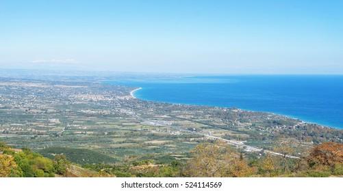 Top view on Mediterranean Sea bay with town on coast. Paralia Panteleimonos, Pieria, Greece.
