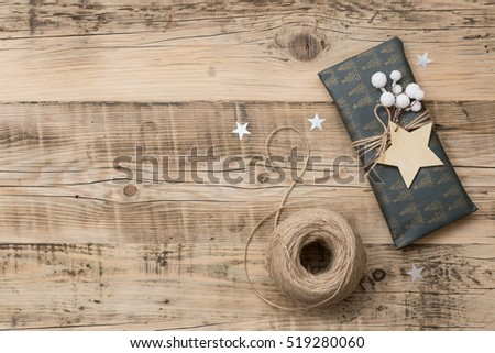 top view on nice christmas gifts packed in black and striped paper and decorated with stars - Nice Christmas Gifts