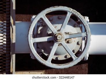 top view on old handwheel of valve in a dark background