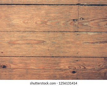 Top view on an old parquet floor. Can be used as a background.