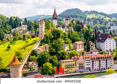 Top view on the old town with fortification wall and towers in Lucerne city in Switzerland