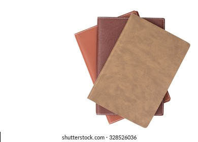 Top view on the pile of books isolated on white background