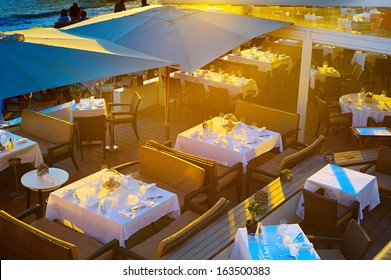 Top view on the restaurant in sunset lights, Cannes