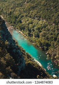 Top view on the River Ardeche with numerous canoes