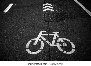 The top view on the road marking and the symbol of a bicycle lane on the asphalt.