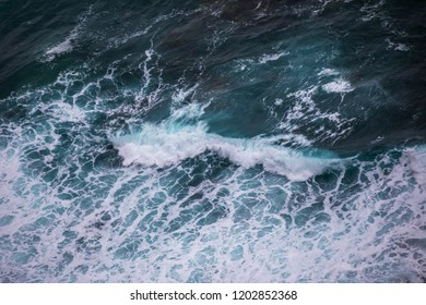 The top view on the seashore, an oceanic surf. Coast of the Pacific Ocean