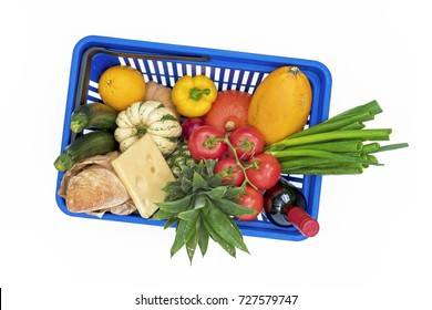 Top view on shopping basket filled with fresh vegetables, cheese and bread iolated on white background.