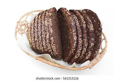 top view on sliced rye bread on white backdrop