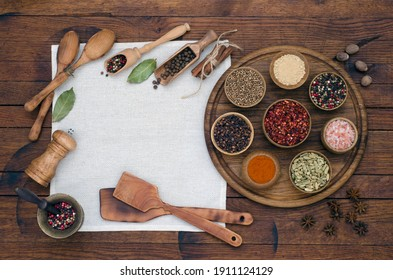 Top view on spices and herbs on wooden table. Food and cuisine ingredients in rustic style. Flat lay.