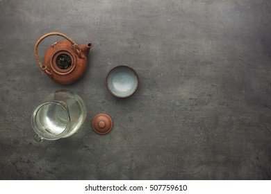 Top view on teapot and green tea accessories.