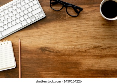 Top view on wood table desk top with working items composition copy space for text, simplicity lifestyle concept