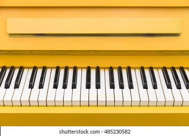 Top view on yellow piano. Closeup of piano keys. Music concept