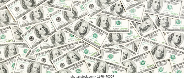 Top view of one hundred dollar banknotes made as a background. USD currency concept. Texture of American dollars.