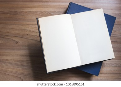 Top view Open book, open vintage book, hardback books on wooden table background,