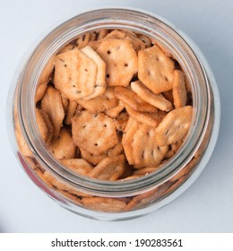 top view of an  open bottle jar with salt biscuits in it