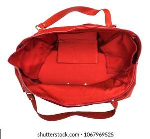 top view of open empty red travelling bag isolated on white background