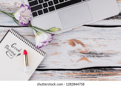 Top view of open laptop computer and bouquet of lisianthus flowers. Holiday in office, business concept. Womens day, march 8.