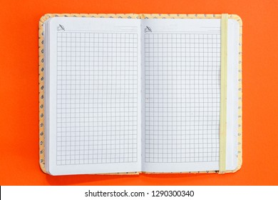 Top view open notebook on orange colorful background.