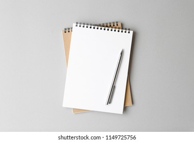 top view of a open notebook with pen on a gray background, school notebooks with a spiral spring, office notepad flat lay