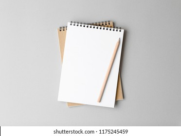 top view of a open notebook with pencil on a gray background, school notebooks with a spiral spring, office notepad flat lay