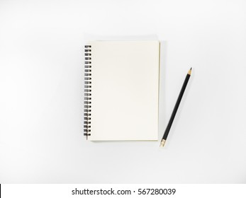 Top view open notebook and pencil potted on white background.