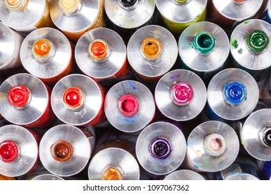 Top view of open professional paints in tubes. Multicolor