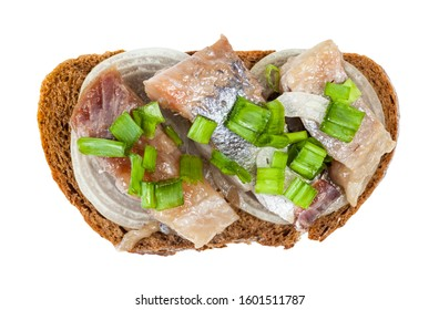 top view of open sandwich with rye bread, pickled herring and onion isolated on white background