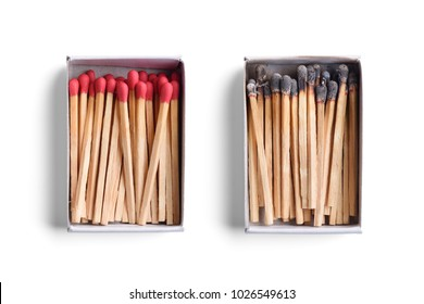 Top view of opened match boxes with burned matchsticks. Isolated on white background